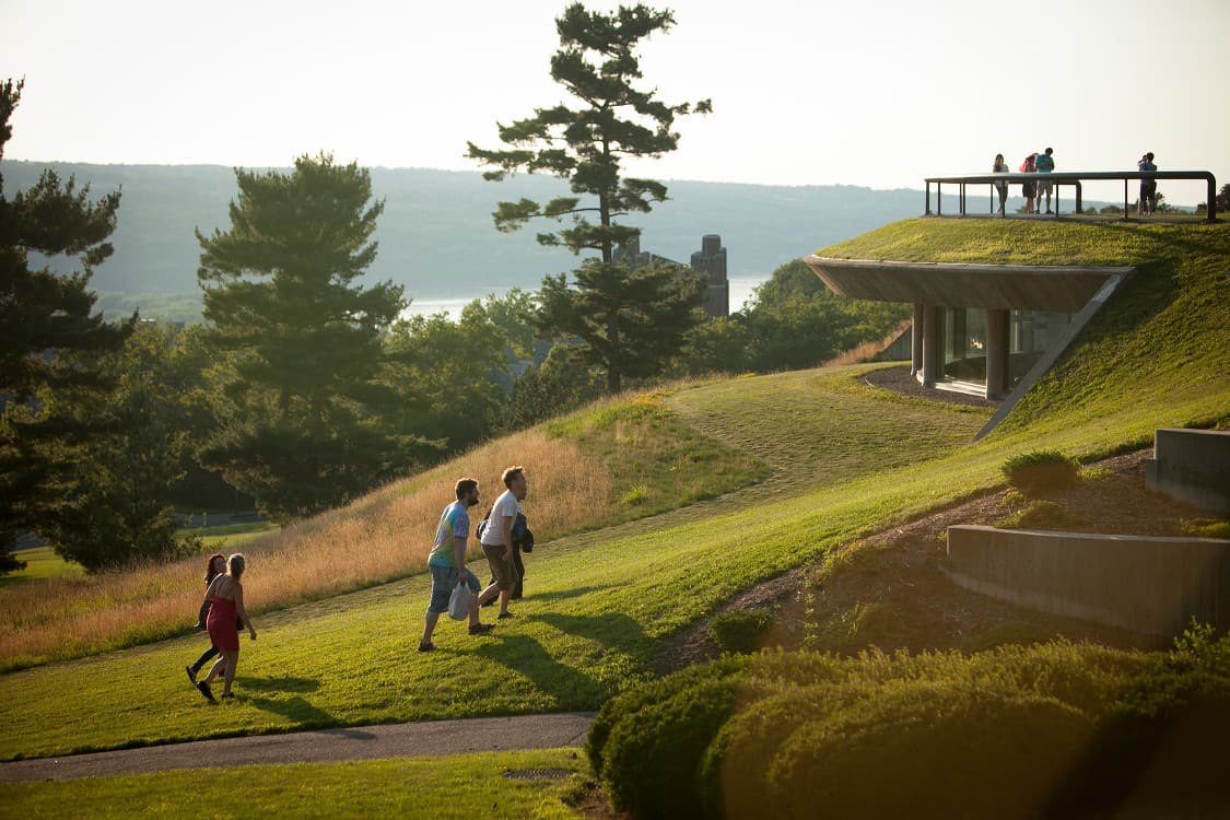 Students walk up Libe Slope in summer.